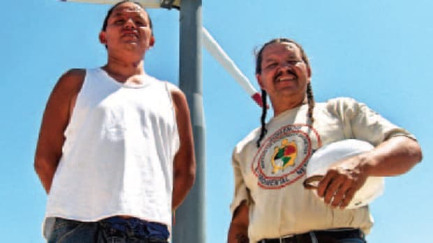Red Cloud, with his son, Silas, left, has been working with renewable energy for more than a decade, and started his own company, Lakota Solar Enterprises, in 2006. (Courtesy TWP)