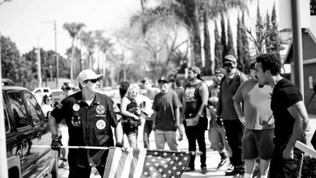 The KKK rally on Saturday in Anaheim's Pearson Park was small, consisting of six Klan members in black shirts in a black SUV. About 100 protesters of multiple ethnic backgrounds greeted the Klansmen upon their arrival at Pearson Park, which was no doubt chosen as the rally site because it hosted a Klan event in 1924 that drew 20,000 people.