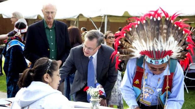 "Yakama Nation celebrated the return of civil and criminal jurisdiction at an April 22 event. Yakama Tribal Councilman, Raymond ""Moss"" Smartlowit, right, signs a guest book with Washington State officials."