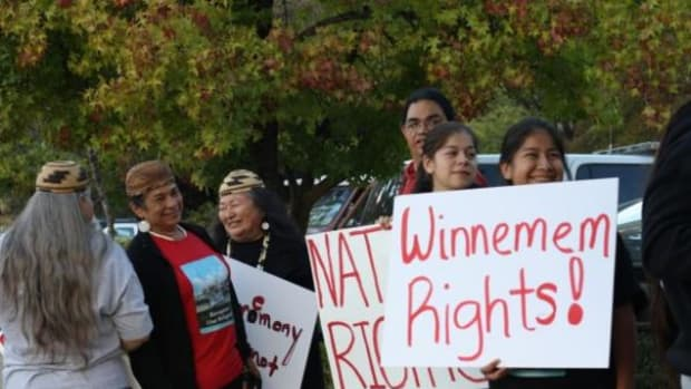Winnemem Wintu Chief and Spiritual Leader Caleen Sisk (in the red shirt) is flanked by tribal members, who along with supporters protested her ceremony citations outside the federal courthouse in Redding, California on October 16. The charges were dismissed by the court.
