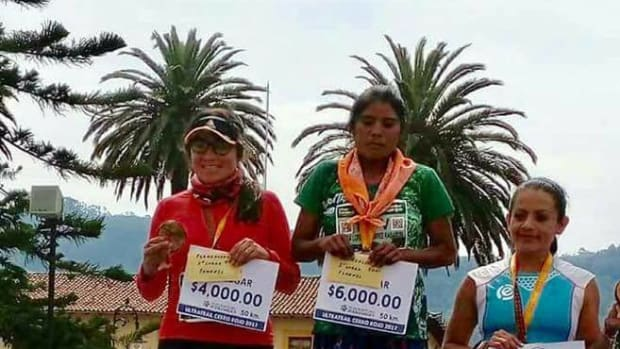 María Lorena Ramírez, 22, is awarded first place after running a 31-mile ultramarathon in sandals.