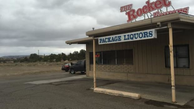 One of Gallup's package stores, surrounded by arroyos that are magnets for alcoholics.