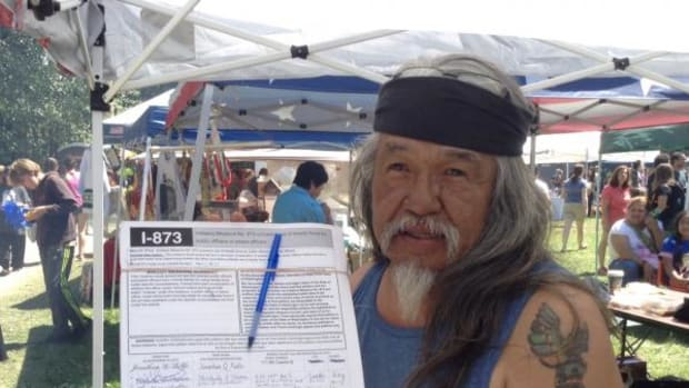 Rick Williams, older brother of Seattle Police shooting victim John T. Williams, gathers signatures for Initiative Measure No. 873, the John T. Williams Bill, at this year's Seafair Indian Days Pow Wow. If the initiative passes, Washington State prosecutors will be better able to charge police officers with crimes if they misuse deadly force.