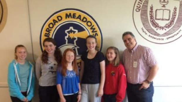 """Marc Paiva (right) and the """"History Girls"""" after their presentation on June 13, 2014."""