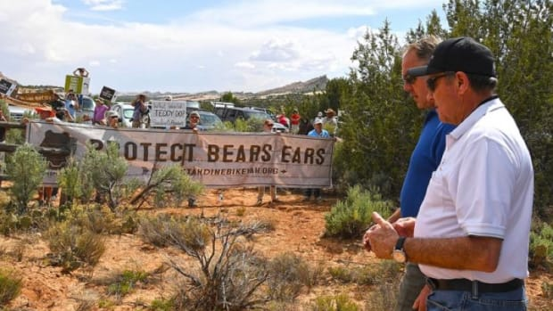 U.S. Secretary of the Interior Ryan Zinke, left, and Utah Gov. Gary Herbert walked past protesters during a visit to the Bears Ears National Monument in Utah 0n May 8, 2017 (Photo courtesy of US Department of the Interior).