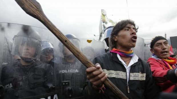 Protesters clash with police as they try to enter the National Assembly in Quito, Ecuador, Thursday March 22, 2012.