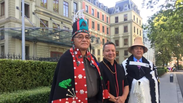 Left to right: Chief Na'Moks (John Ridsdale) of Wet'suewt'en, Kirby Muldoe and Skil Hiilans (Allan Davidson) of the Haida Nation.