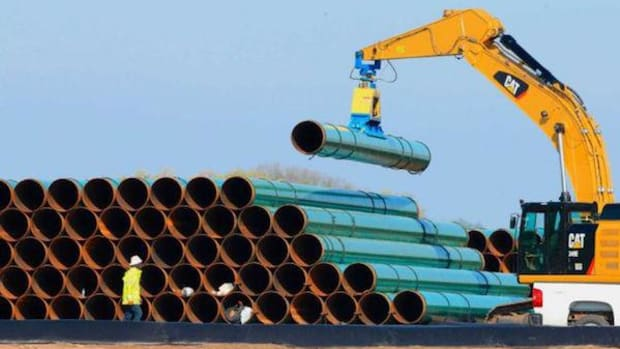 Pipes for the proposed Dakota Access Pipeline are stacked at a staging area in Worthing, S.D. The pipeline will stretch from the Bakken oil fields in North Dakota through South Dakota and Iowa to a hub in Illinois. The project would move at least 450,000 barrels of crude daily from the Bakken oil fields.