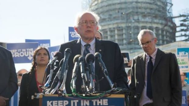 Presidential hopeful Bernie Sanders, center, and Tara Houska, left, during a Keep It In The Ground Act press conference in Washington, D.C. on November 4, 2015. On Tuesday, Houska was appointed to the position of Native American Advisor to Sanders.