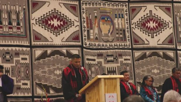 American Indian Higher Education Consortium Student Congress President Dwight Carlston delivers the invocation at Navajo Technical University's fall commencement on December 12, 2014.