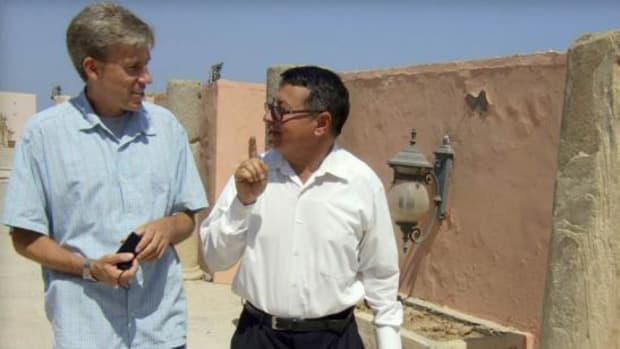In this photo posted on the U.S. Embassy Tripoli Facebook page on August 27, 2012, U.S. Ambassador to Libya Christopher Stevens, left, walks with an unidentified translator during a tour of Assaraya al-Hamra, or the Red Castle in Tripoli, Libya. Libyan officials say the U.S. ambassador and three other Americans have been killed in an attack on the U.S. consulate in the eastern city of Benghazi by protesters angry over a film that ridiculed Islam's Prophet Muhammad.