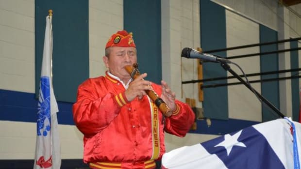 U.S. Marine and Native American Fred Vigil plays his traditional flute at a Reno-Sparks Indian Colony Veterans Day Celebration.