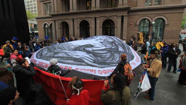Protesters erected a parachute outside Citibank's annual shareholders' meeting in New York City to protest the bank's funding of pipelines.