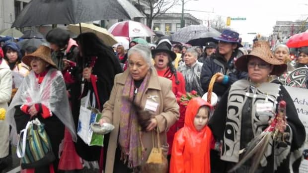 Hundreds of people turned out in heavy rain for the 20th annual Women's Memorial March to honor the memories of Canada's murdered and missing women, shutting down traffic and drawing crowds as they wound through the streets and alleys on the Downtown Eastside