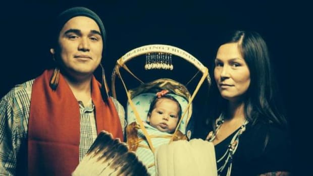 Lowicha Lake Falls-Rock—pictured here with his child Haluma Charging Thunder Blackowl and girlfriend Zintkala Mahpiya Wi Blackowl—alleges he lost his job with the Nez Perce Tribal Police Department because of his traditional religious beliefs.