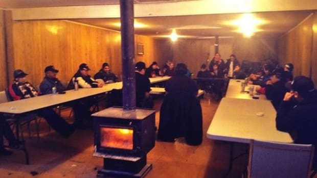 Leadership of the Lubicon Lake Cree Nation meet in their longhouse to discuss the Penn West court order and their anti-fracking blockade.