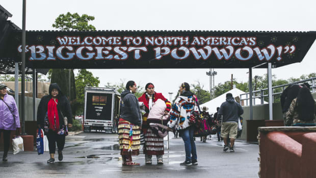 "Just outside the Tingley Coliseum in Albuquerque, a sign reading ""North America's Largest pow wow"" welcomes visitors to the new Gathering of Nations pow wow grounds. Thosh Collins"