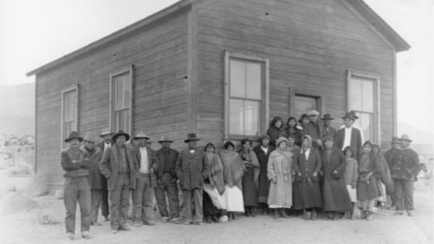 Photo of the Owens Valley Paiute in front of their community center about the time of the Piper v. Big Pine School District case. Alice Piper is the first left in the back upper row; her father, Pike Piper, is the first left in the front row.