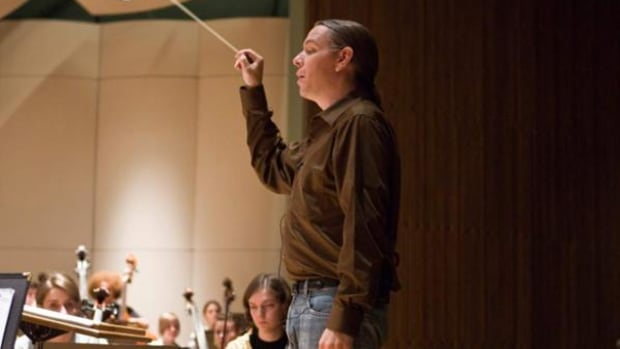 Chickasaw Nation composer-in-residence Jerod 'Impichchaachaaha' Tate conducts an ensemble during rehearsals for the 2011 Chickasaw Chamber Music Festival