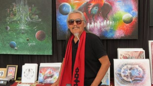 Artist Rex Begaye with some of his work at the Sarasota Native American Indian Festival