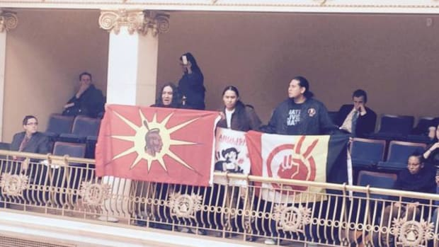 Native Americans protest Senator Todd Weiler in the Utah Senate gallery over offensive comments he made with relation to a bill to repeal Columbu Day in the state.