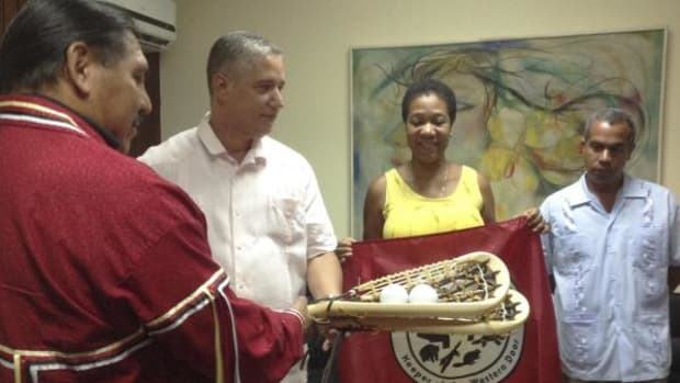 Delegates from the Seneca Nation and Native American Finance Officers Association share a part of their culture in Havana, Cuba during a conference geared toward uniting American Indian tribes and the island nation with a presentation of traditional Lacrosse sticks.