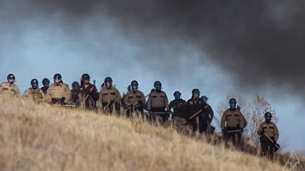 North Dakota Gov. Jack Dalrymple declared a state of emergency to marshal resources, including militarized police from seven states, to confront unarmed water protectors at Standing Rock.