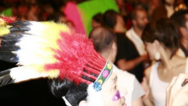 There's cultural appropriation, dressing up like an Indian for Halloween, with the fake feathers and fringe, but saying you are Native American when you are not, is also an issue. This image is from a Halloween party in West Hollywood in 2011.