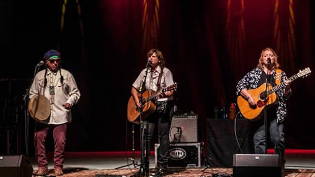Keith Secola performing with Indigo Girls Amy Ray and Emily Saliers, in Albuquerque on July 30. Photo by Jason Morgan Edwards.