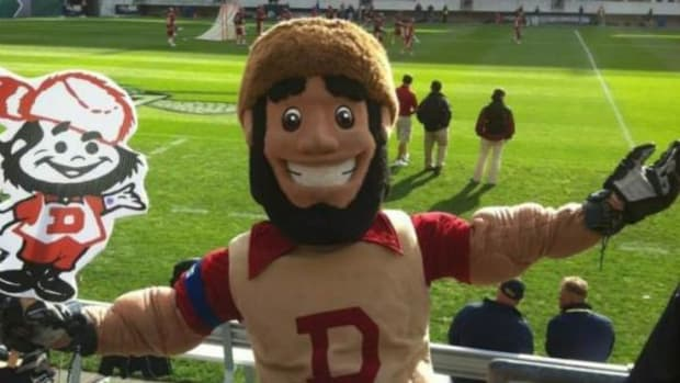 """Coonskin cap-wearing """"Denver Boone,"""" a longtime University of Denver mascot, was ousted from that role 15 years ago, although he continued as an informal DU image over the years among loyal fans. Denver Boone has been officially excluded from a process now underway to select a DU mascot that would be acceptable and appropriate to the full student body known as the """"Denver Pioneers."""""""