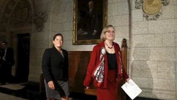 Canada's Indigenous Affairs Minister Carolyn Bennett (R) and Justice Minister Jody Wilson-Raybould arrive at a news conference regarding a ruling by the Canadian Human Rights Tribunal on Parliament Hill in Ottawa, Canada, January 26, 2016. They have promised to ensure that the government takes action.