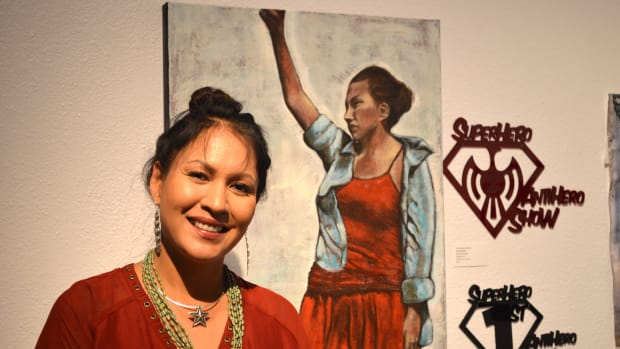 """Avis Charley, a contemporary ledger artist of the Ihanktonwana Dakota Oyate band of the Oceti Sakowin and Diné (Navajo) Nation, took home the Grand Prize and First Place titles for her painting """"Woman of Nation."""""""