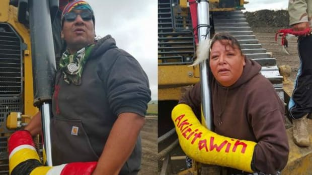 Water protectors in North Dakota locked themselves to construction equipment in non-violent direct action against the Dakota Access Pipeline Tuesday.