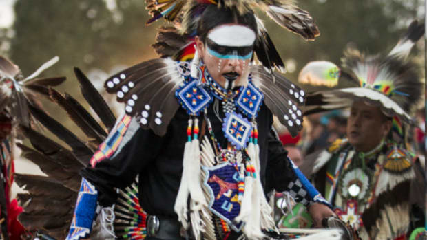 Apache northern traditional dancer, Harley Upton Jr. of Neb. dances during grand entry on Saturday afternoon, June 1, 2013, during the 16th Annual Powwow in the Pines. The casino powwow took place in the White Mountain Apache Tribe reservation in Arizona.