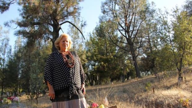 Betti Comas, Winnemem Wintu elder, walks among the Curl plot where many of her relatives are buried in the Shasta Reservoir Indian Cemetery. When the Shasta Dam was built, Comas's pregnant mother lost her home, was never compensated and had to live in a tent at what is now the Redding Rancheria.