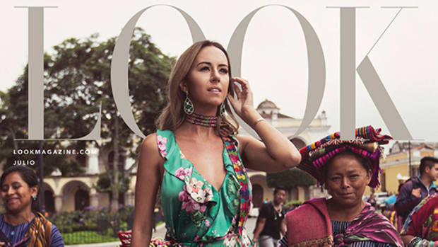Indigenous, Founder of IX Style, Francesca Kennedy, wears floral dress surrounded by Maya people.