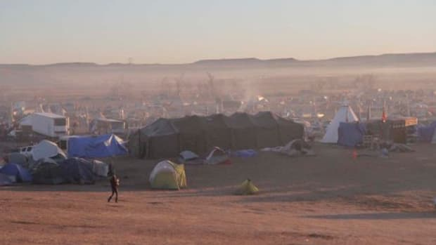 The sun rises over Oceti Sakowin Camp just north of the Cannonball River where 2,000 opponents of the Dakota Access Pipeline have been living. Opponents began arriving in small numbers in April. Larger numbers came in July and August, and more continue to arrive every day.
