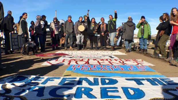 Members of the Two Spirit Nation raise their fists in the air in solidarity for the ongoing, but dwindling water protectors movement near the Standing Rock Sioux reservation.