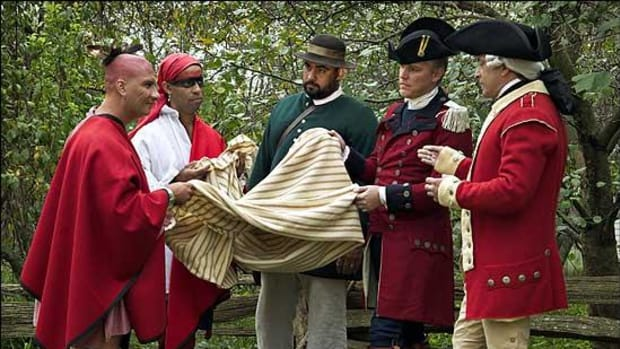 British Captain Simeon Ecuyer, portrayed by Ken Treese, second from right, offered blankets infected with smallpox to the Indians besieging Fort Pitt. From left, interpreters Christopher Jones, Ted Boscana, Treese, and Patrick Andrews.