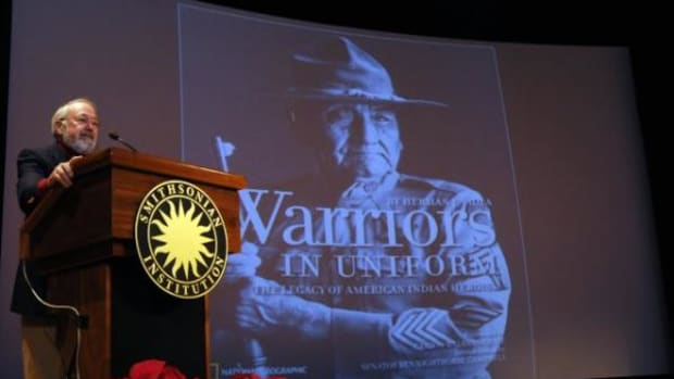 Herman J. Viola speaks to guests at the National Museum of the American Indian Dec. 2, 2011, during the presentation, Our Warrior Spirit: Native Americans in the U.S. Military.