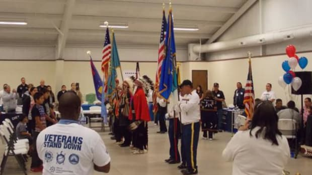Members of the Oklahoma Inter-Tribal Veterans Association Buddy Bond Chapter and the Kiowa Black Leggings Society present the colors at the Stand-Down's opening ceremonies.