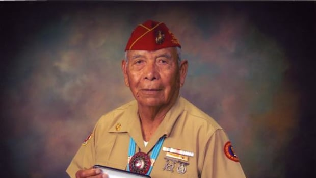 Joe Morris Sr. is seen here in 2009 with the Silver Congressional Medal of Honor, which was awarded to the Navajo code talkers in November 2002. Around his neck is a handmade beaded bolo with the Marine Corp. emblem in the middle.