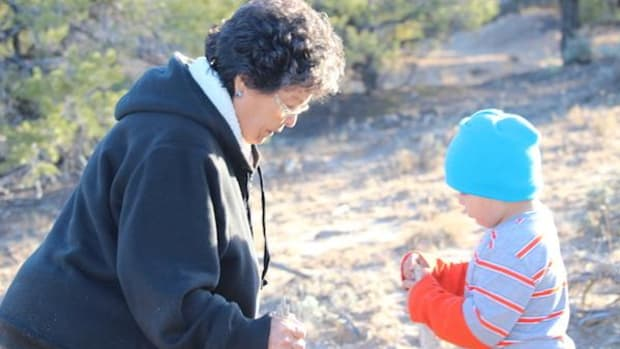 Sarah Jane White, helping defend Navajo lands from virtually unregulated oil exploration, plays with her grandson.