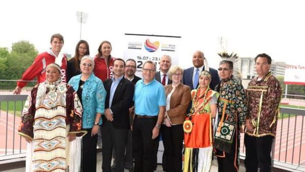 Officials from the Ontario and Canadian governments were among those on hand for a news conference in Toronto to announced funding for the 2017 North American Indigenous Games. Here, overlooking the York Lions Stadium, which will host several of the events at the 2017 NAIG, are Traditional grandmother Kim Wheatley; Chief Ava Hill, Six Nations of the Grand River; Michael Levitt, MP York Centre; Hon. David Zimmer, Ontario Minister of Aboriginal Affairs; Carla Qualtrough, Federal Minister of Sport and Persons with Disabilities; Alexandria Bipatnath; Elder Garry Sault and Councilor Evan Sault, Mississaugas of the New Credit First Nation. Back row, left to right: three athletes from former Games—Keir Johnson (canoe/kayak), Lauren King (basketball and golf) and Mekwan Tulpin (basketball and assistant coach lacrosse); Rob Lackie, operations manager of 2017 NAIG; York University President and Vice-Chancellor Mamdouh Shoukri; Michael Coteau, Ontario Minister of Tourism, Culture and Sport.
