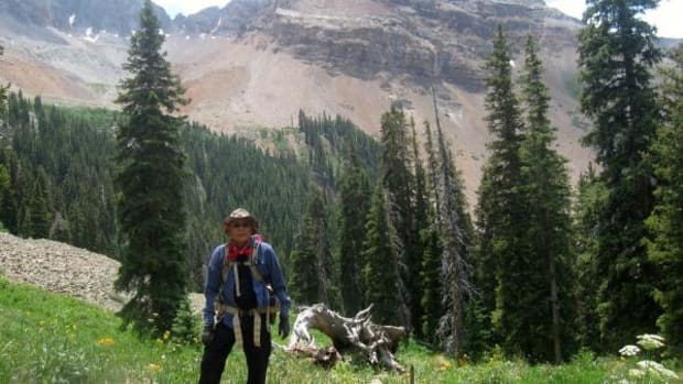 Tommy Allen hiking one of the sacred mountains in Navajo country with Mount Hesperus in the background.