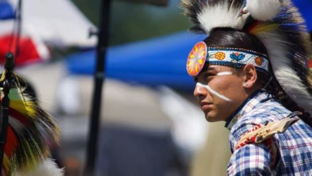 Julian Brave NoiseCat, a citizen of the Secwepemc (Shuswap) Nation, is finely bedecked in his regalia in this 2012 photo.
