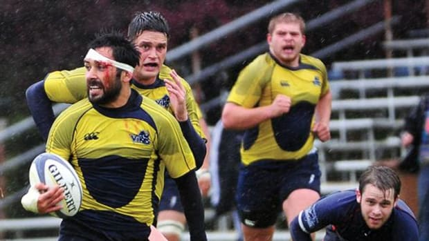 First Nation member Phil Mack, with ball, has signed a contract to play rugby for a professional team in Wales.