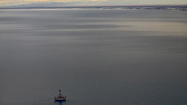 First aerial photos of the Royal Dutch Shell floating oil drilling unit, Kulluk, in the Beaufort Sea, as it prepares to begin initial work on an exploratory oil well beneath the Arctic Ocean floor north of Alaska, October 7, 2012.  The drill rig is only 12 miles offshore of the western boundary of the Arctic National Wildlife Refuge, which can be seen in the photograph.
