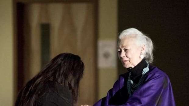 Rulan Tangen, artistic director of Dancing Earth Creations, a protege of Daystar's, bows to her mentor on April 11, when Jones was presented with a Lifetime Achievement Aware at the Institute of American Indian Arts.