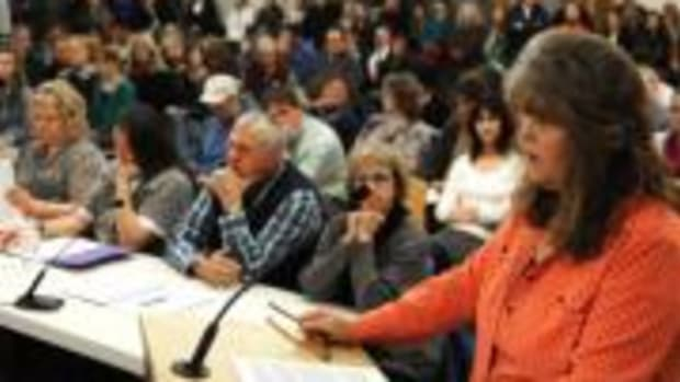 "Gail Supola, a mother upset by the selection of Sherman Alexie's ""The Absolutely True Diary of a Part-Time Indian,"" addresses a packed boardroom. Supola is asking School District 2 to remove the novel from its required reading list and tighten up its classroom opt-out policy."